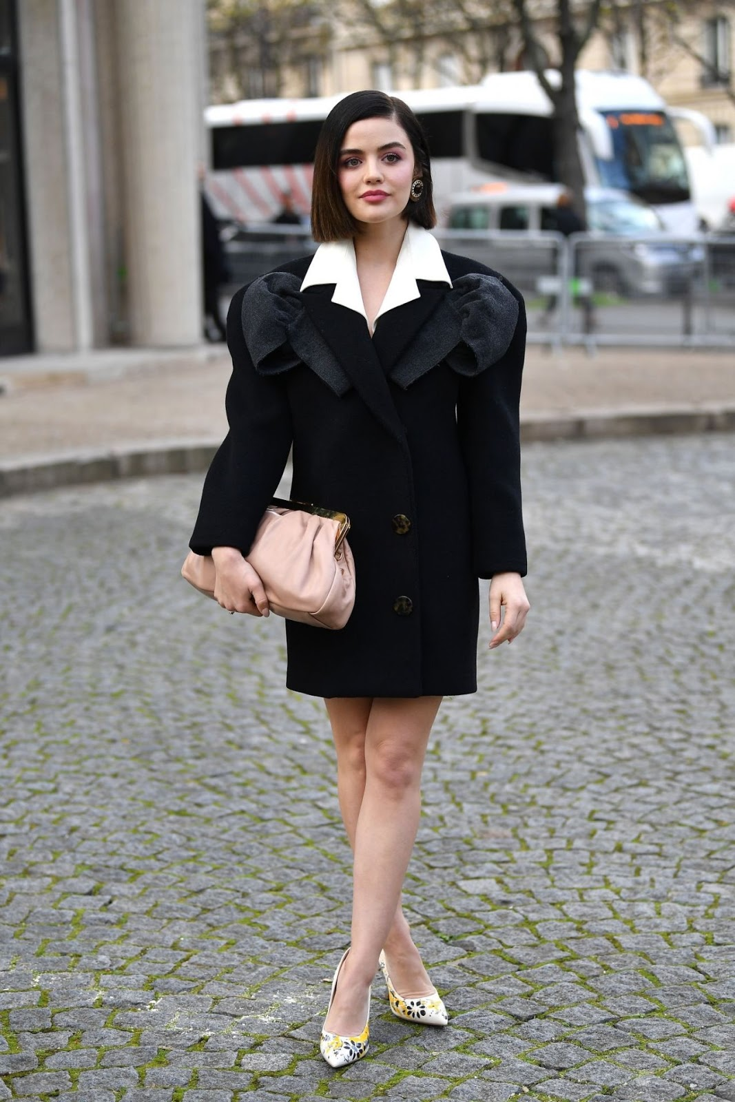 Lucy donned a black long-sleeved blazer dress with a dark grey detail and a large white collar
