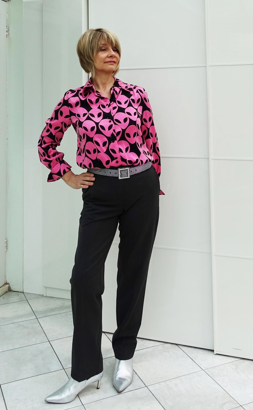 Gail Hanlon from Is This Mutton style blog in Fabienne Chapot Paris blouse worn with grey trousers and silver ankle boots.