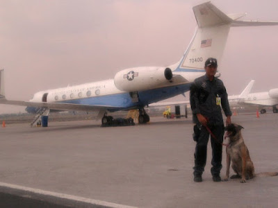 guarding plane in tarmac - k9 unit