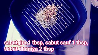 image of dry masala seeds on tawa pan