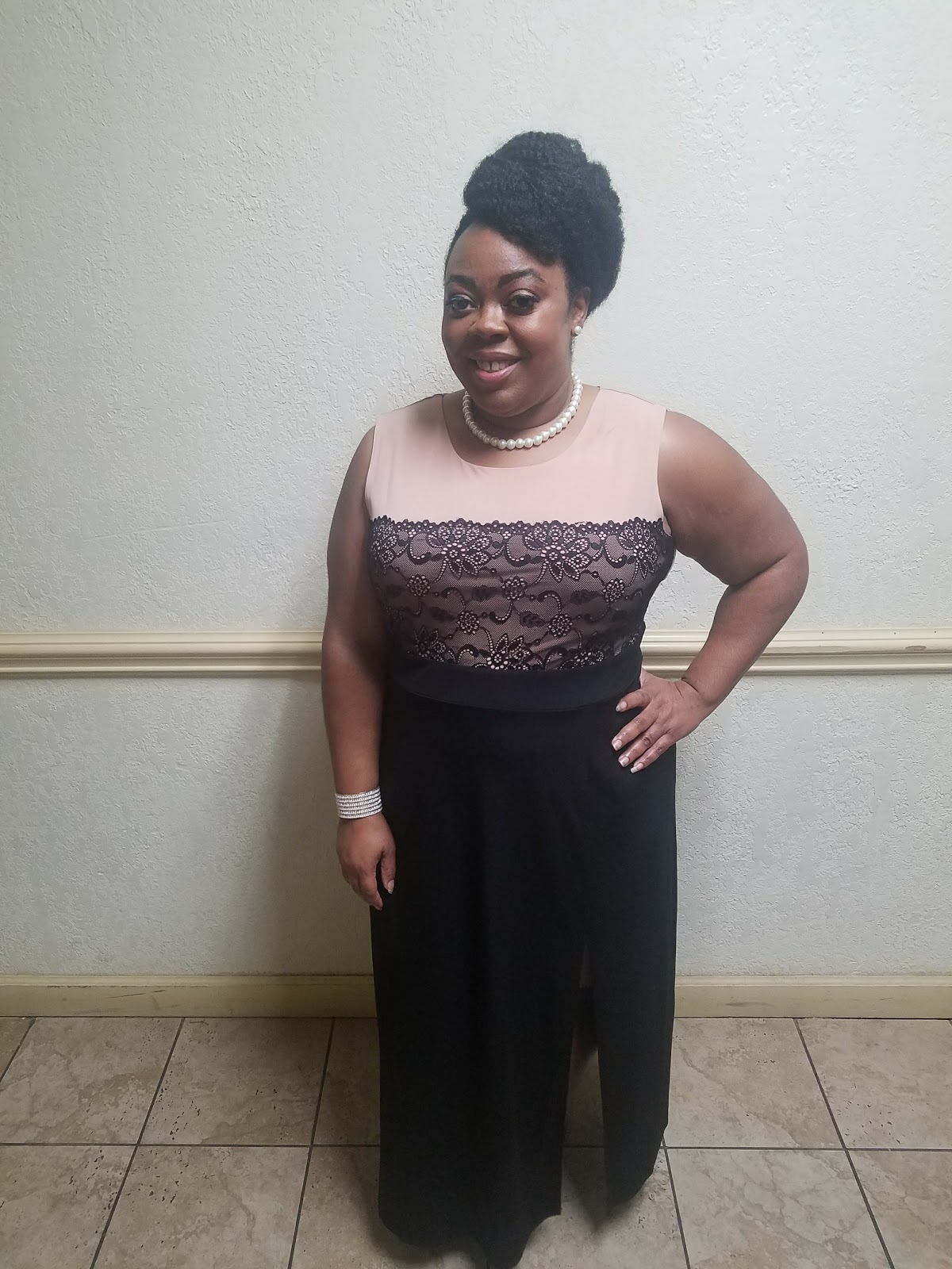 Plus size, model, blush evening gown, natural hair updo, pearl accessories, natural makeup