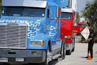 California Air Resources field representative Valente Armenta works a checkpoint set up to inspect heavy-duty trucks traveling near the Mexican-U.S. border in Otay Mesa, California September 10, 2013. (Credit: Reuters/Mike Blake) Click to Enlarge.