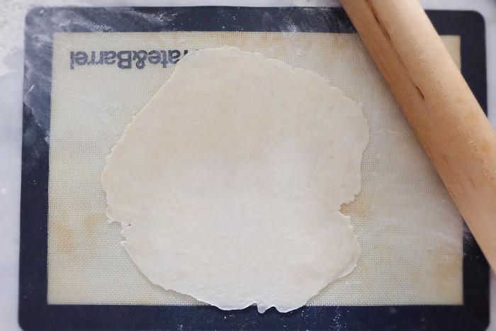 dough segment rolled flat into a circle