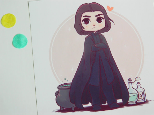 A photo of a print featuring artwork by Naomi Lord of Professor Snape in a kawaii style