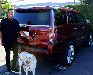Frances Glandney's husband Smokey Robinson picture with car and dog