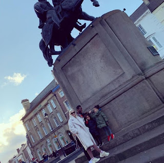 Mikel Obi, his partner and their twin daughters enjoy a stroll in the UK (Photos)