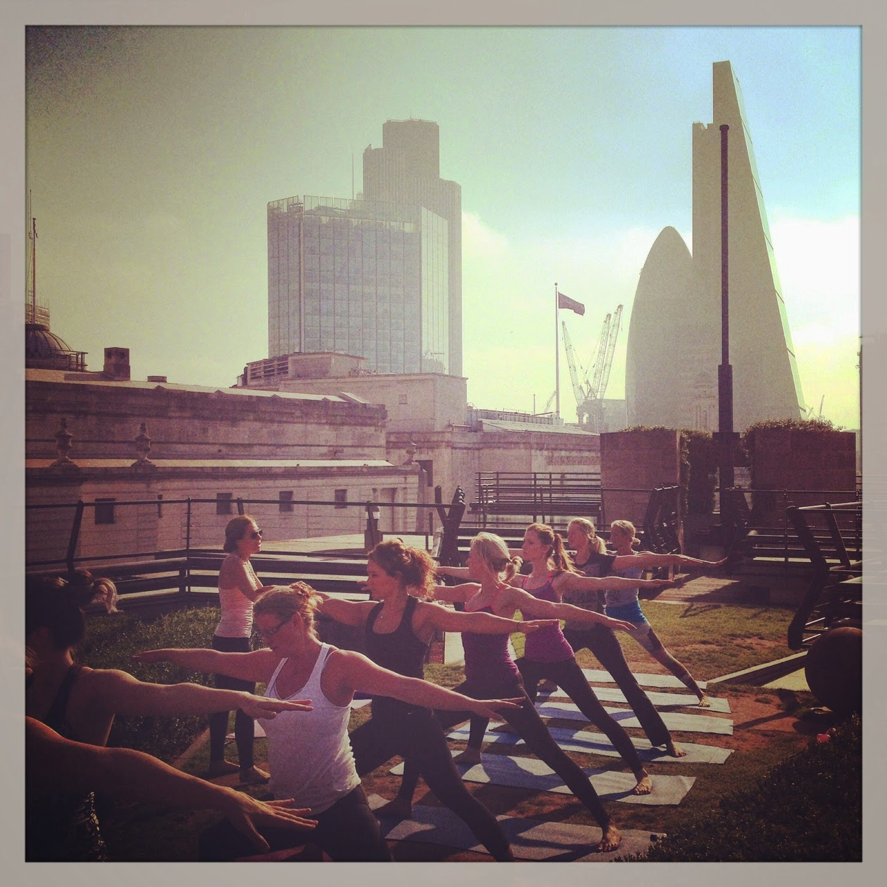 Practicing in the Heights Rooftop Yoga