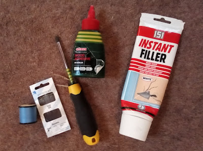 Photo of needle & thread, screwdriver, wood glue and polyfilla