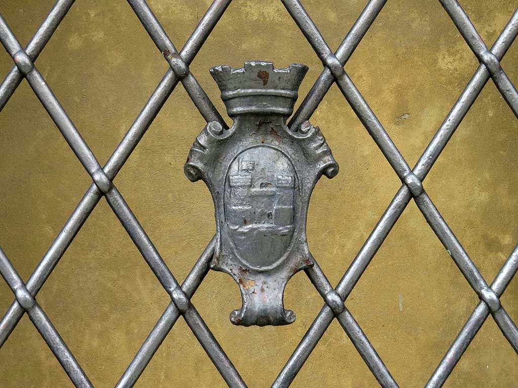 Coat of arms of Livorno on a window with grating, Municipal Building, Livorno