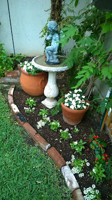 white garden, bird bath in garden