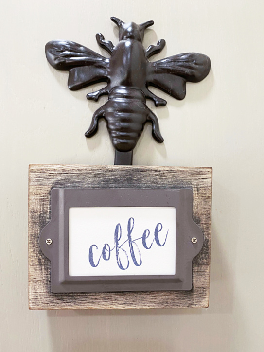 coffee sign hanging with a bee