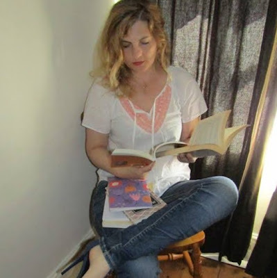 Woman in high heels reading 3 books