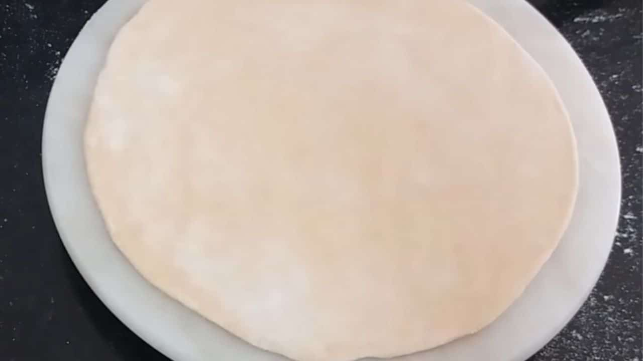 take-a-one-large-portion-of-dough-and-make-big-roti-of-it