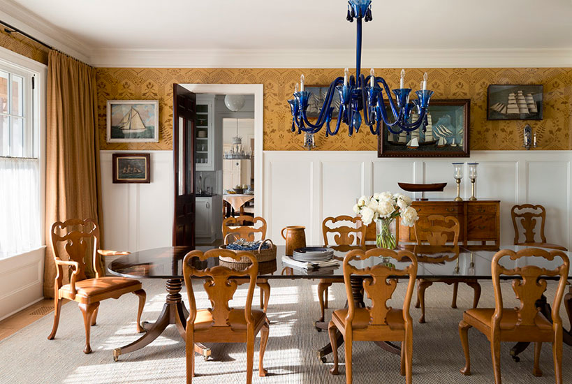 Dining room in Meadowmere Southampton home by Carrier and Company