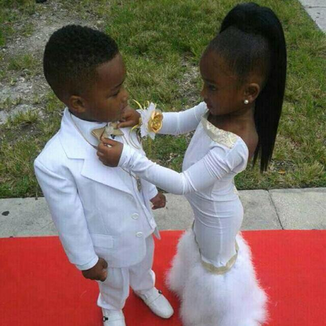 Aww! Check out this little bride and groom