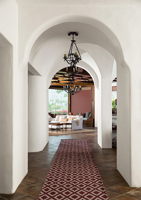 southwestern style entry with dark floor and walls painted with Benjamin Moore Atrium White