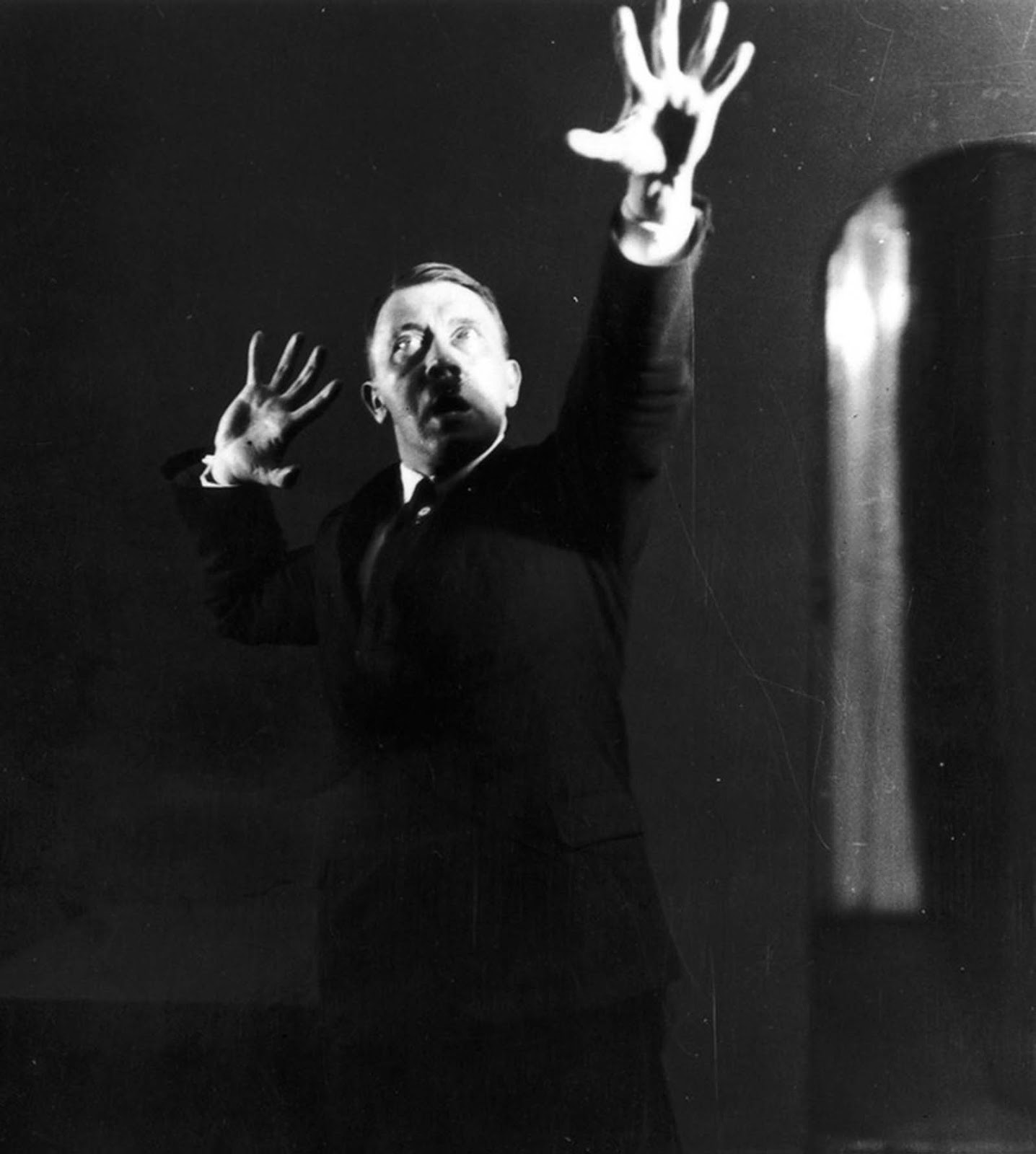 Hitler rehearsing his public speech in front of the mirror.