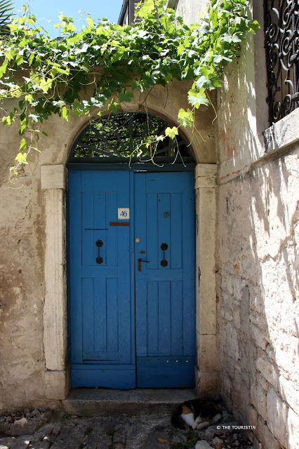 Rovinj, Croatia, Europe, old town. Blue door, wine, cobbled streets.