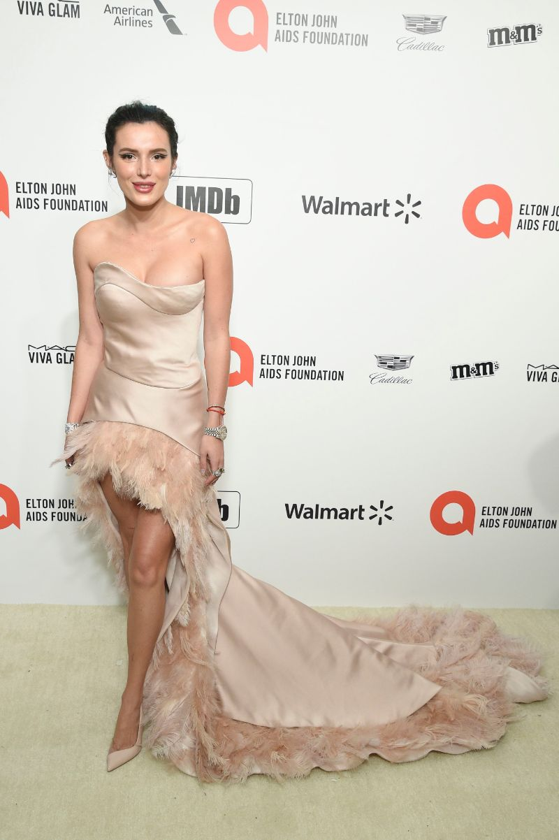 Bella Thorne Goes for an Asymmetrical Look in a Feathered Dress + d'Orsay Pumps at Elton John's Oscar Party