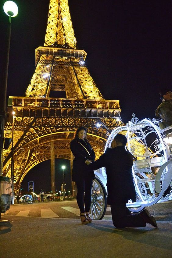 Proposing Will you marry me, in Front of Eifel Tower, both are in black suit