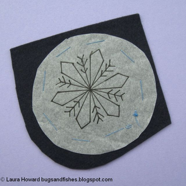 secure the snowflake embroidery pattern to the felt