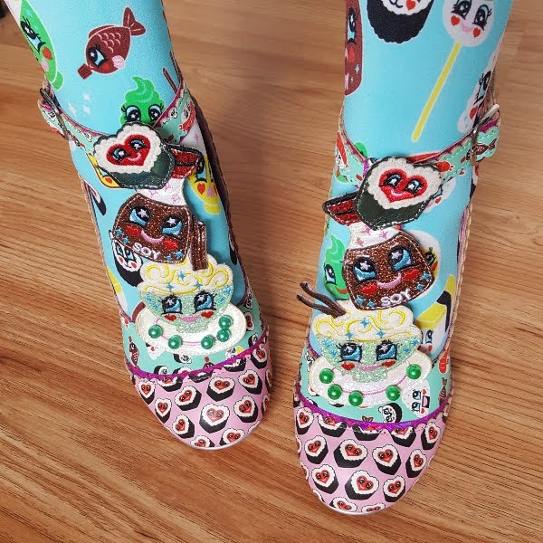 wearing sushi themed T-bar shoes with colourful printed tights