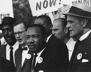 https://commons.wikimedia.org/wiki/File:Civil_Rights_March_on_Washington,_D.C._(Dr._Martin_Luther_King,_Jr._and_Mathew_Ahmann_in_a_crowd.)_-_NARA_-_542015_-_Restoration.jpg