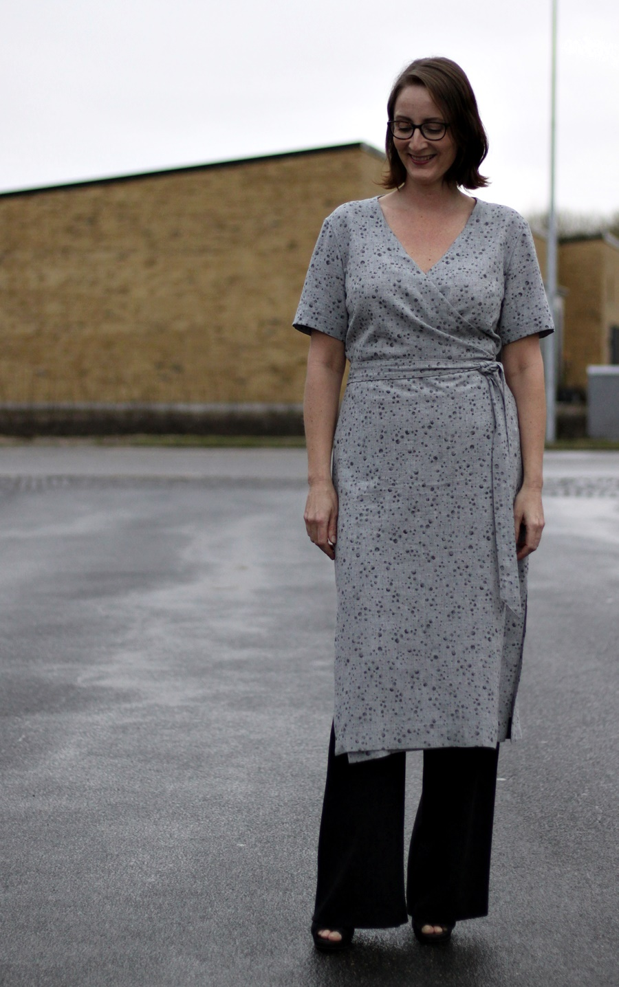 1cc3ac054e28b The weather in Denmark is not yet for bare legs, so I layered my Highlands Wrap  Dress with some wide leg trousers.