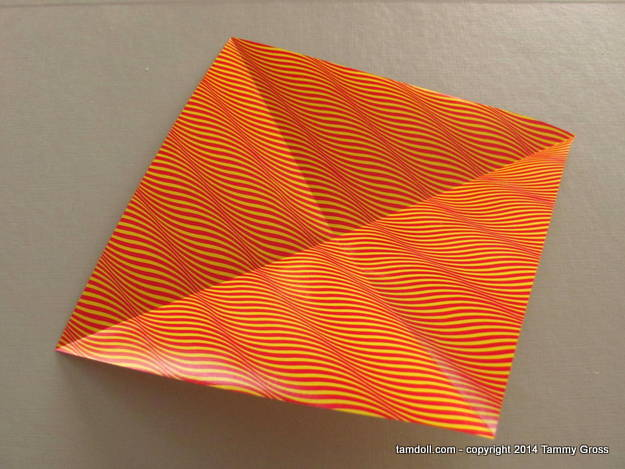 folded paper re-opened