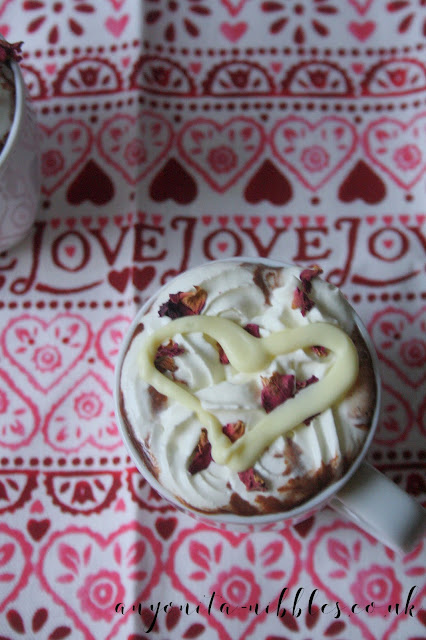 A white chocolate heart on top of an indulgent hot cocoa made from scratch for Valentine's Day | Anyonita-nibbles.co.uk