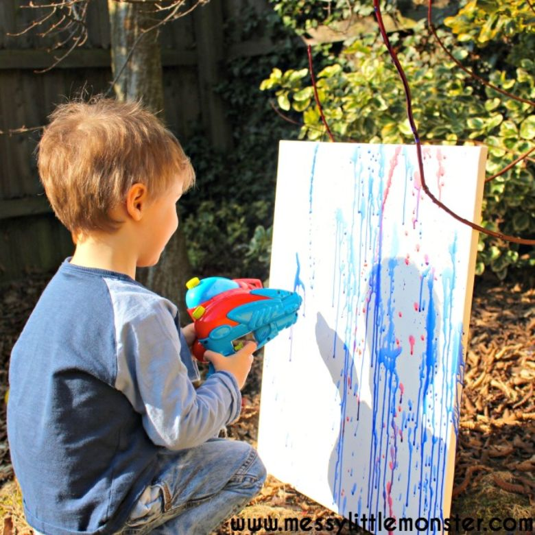 squirt gun painting summer activities for preschoolers