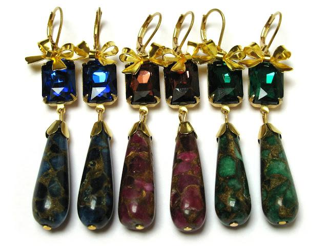 Druppel oorbellen met gouden strikjes