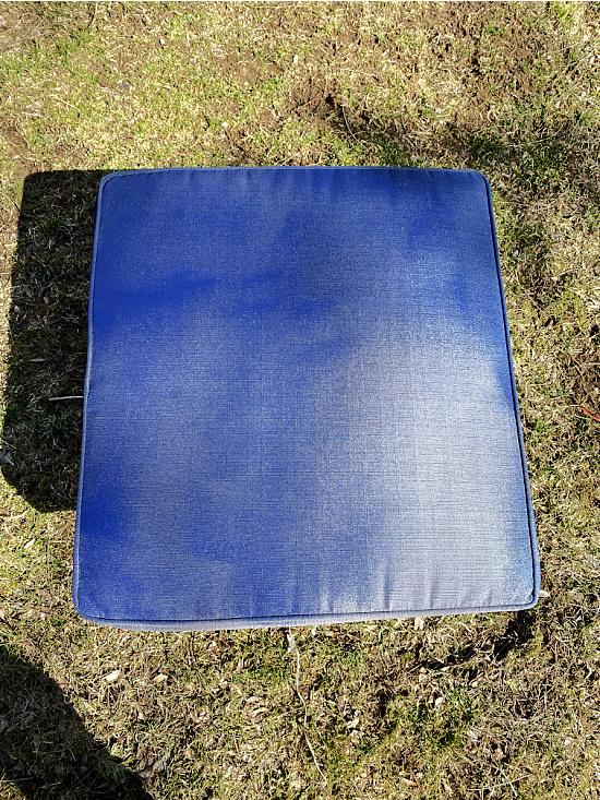 spray painting the cushion navy blue
