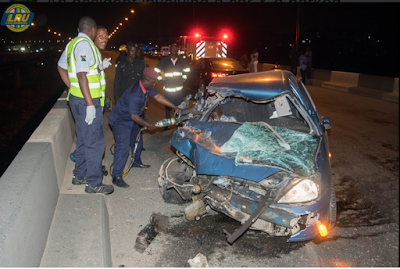 Driver Crashes His Car After Ramming Into Parked Trailer On Ogudu Bridge In Lagos. Photos