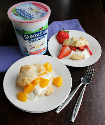 plates of shortcakes filled with yogurt, peaches and strawberries with quart of stonyfield yogurt