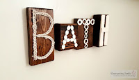 http://repurposingjunkie.com/2016/02/18/bathroom-junky-letterpress-blocks-wall-art/