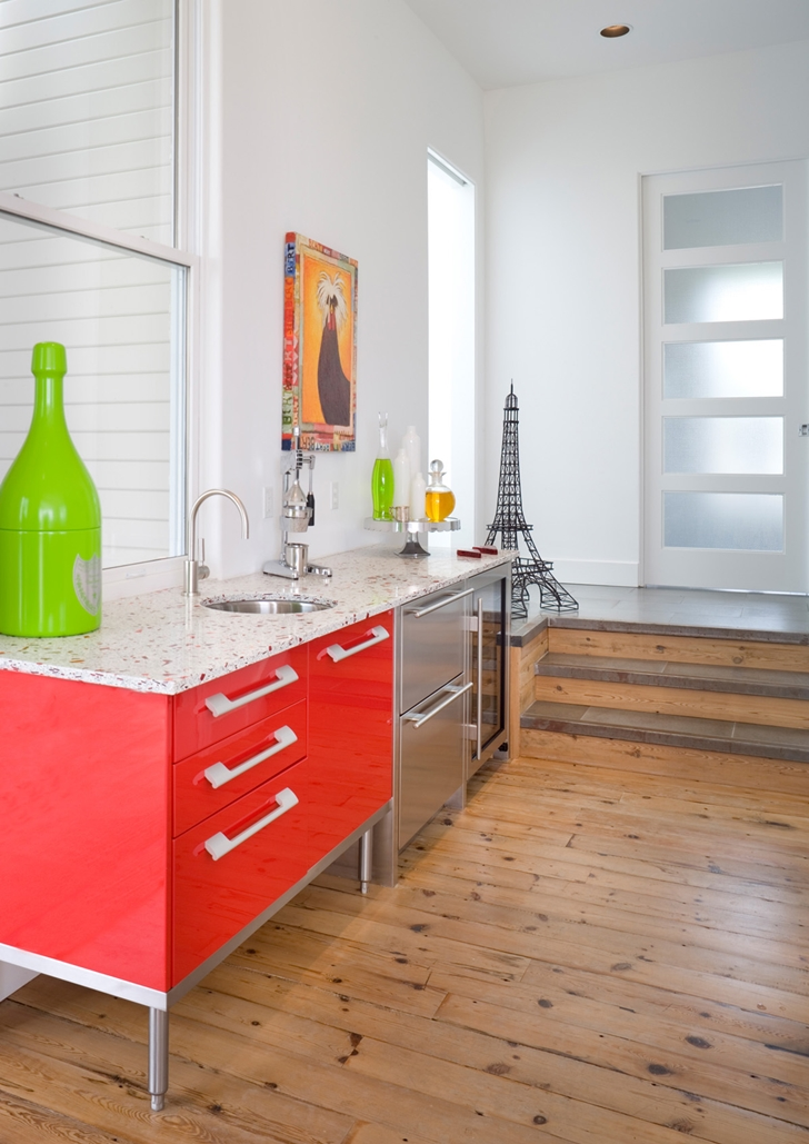 Small red kitchen furniture in Contemporary style home in Oregon by Eric Schnell