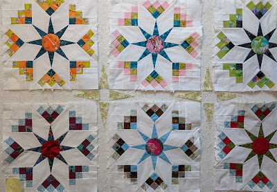 Four-pointed stars of pale green form part of the sashing for the Shadow Star quilt