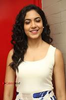 Actress Ritu Varma Stills in White Floral Short Dress at Kesava Movie Success Meet .COM 0123.JPG
