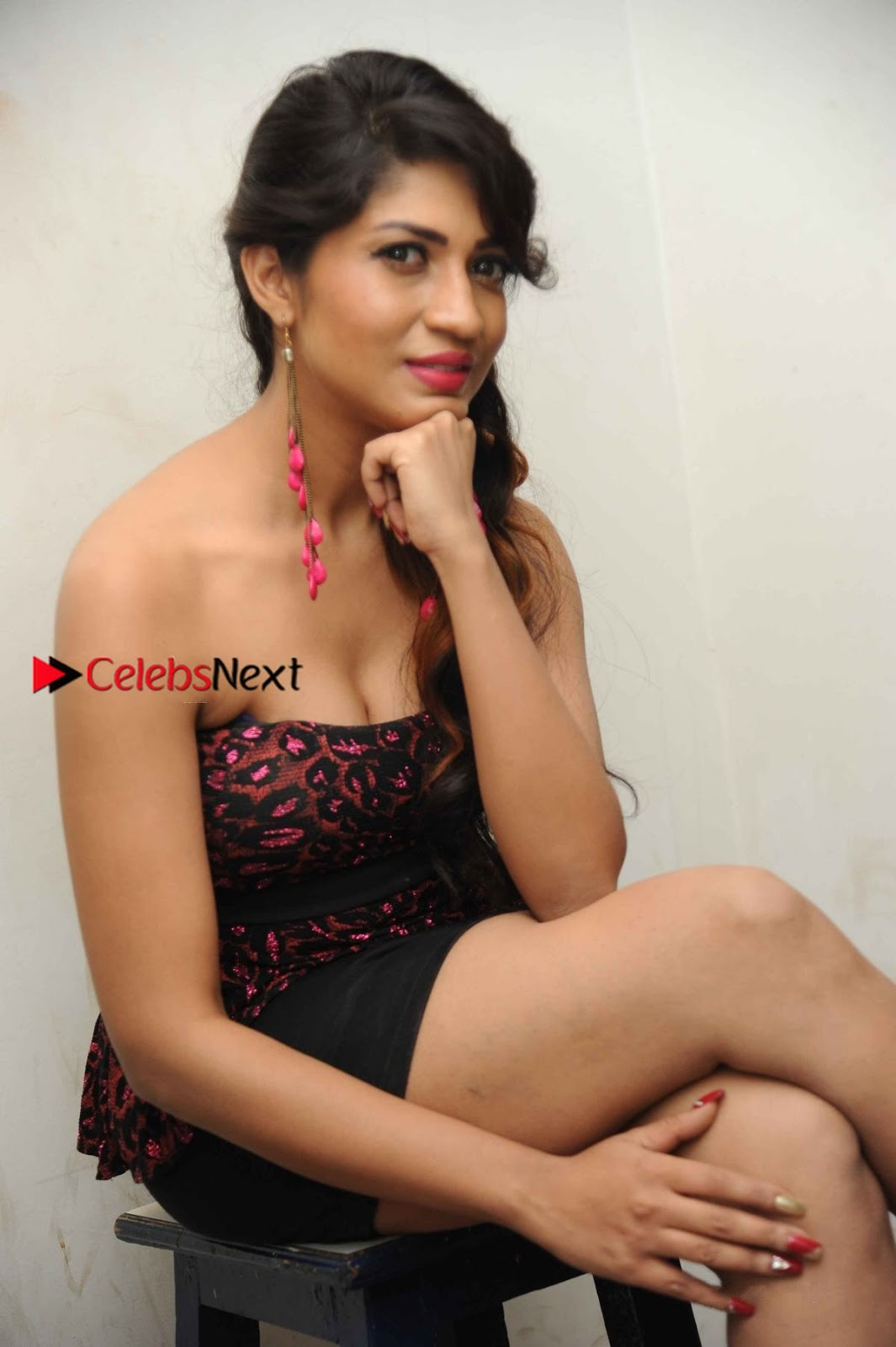 Iti Acharya Stills in Strapless Dress at Dhwani Movie Press Meet