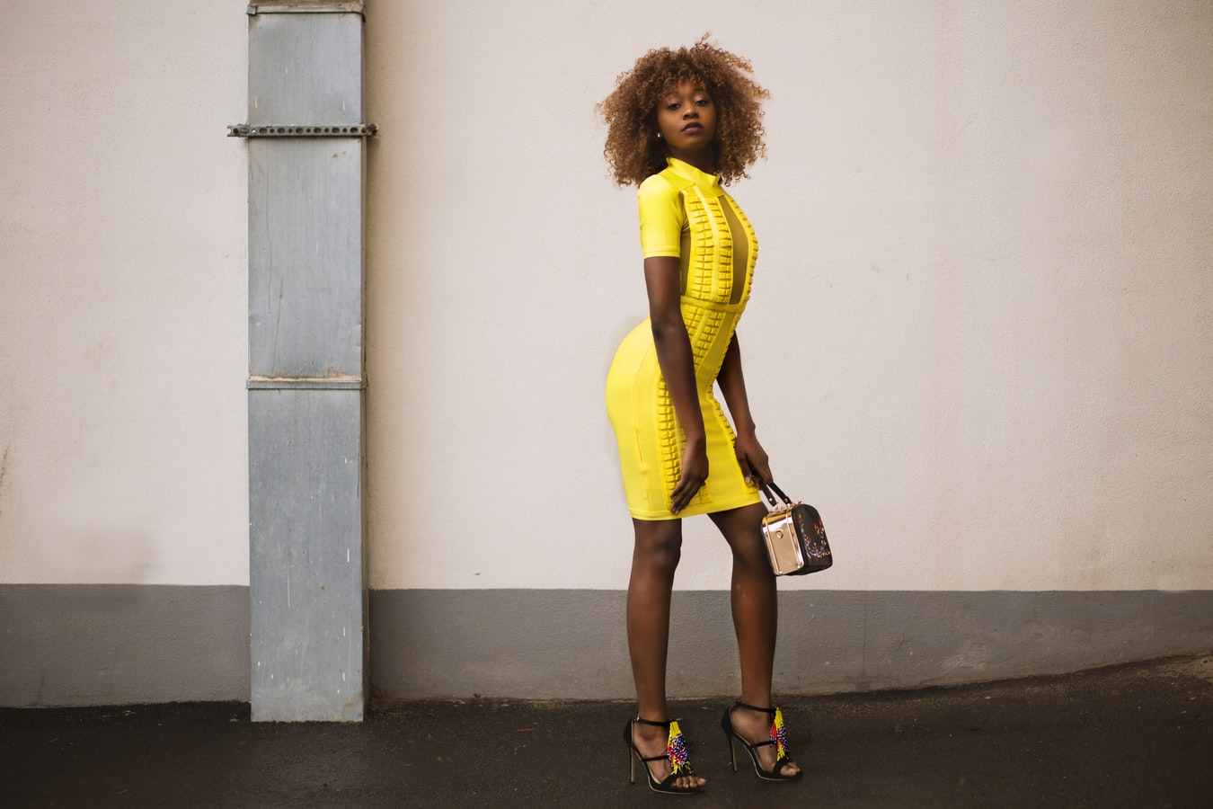 pretty women in yellow bodycon dress
