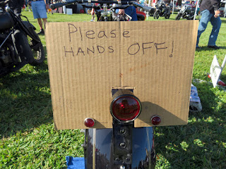 Sign says Please HANDS OFF!