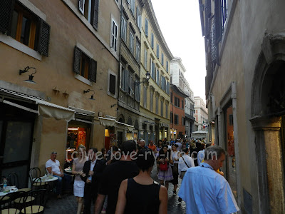 The narrow street is filled with people