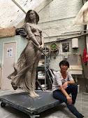 an female Asian artist with her gorgeous female sculpture
