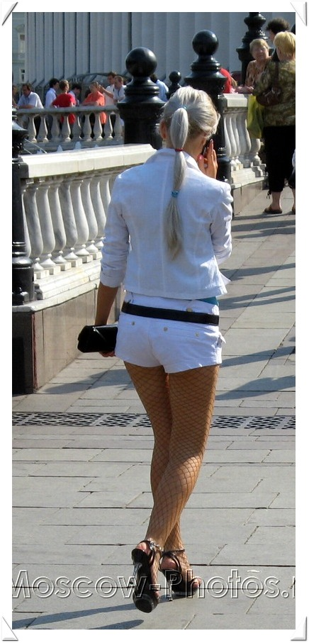 Moscow blonde in white shorts hurries to work