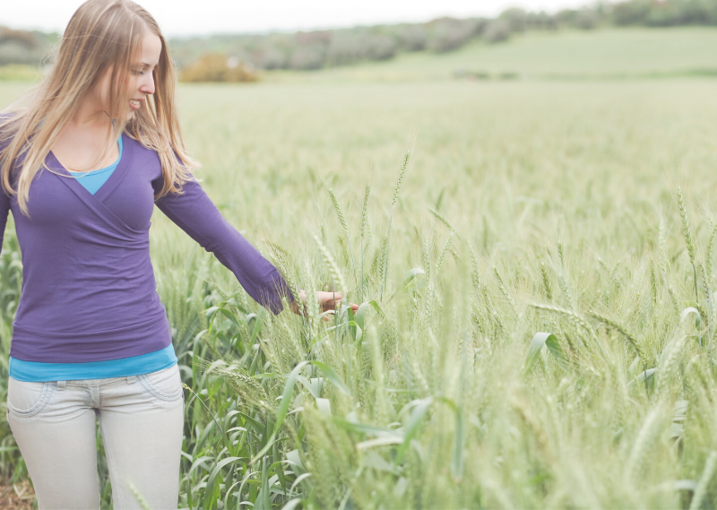 Lady walking in a field in a blog post about 6 things you can do when you feel overwhelmed.