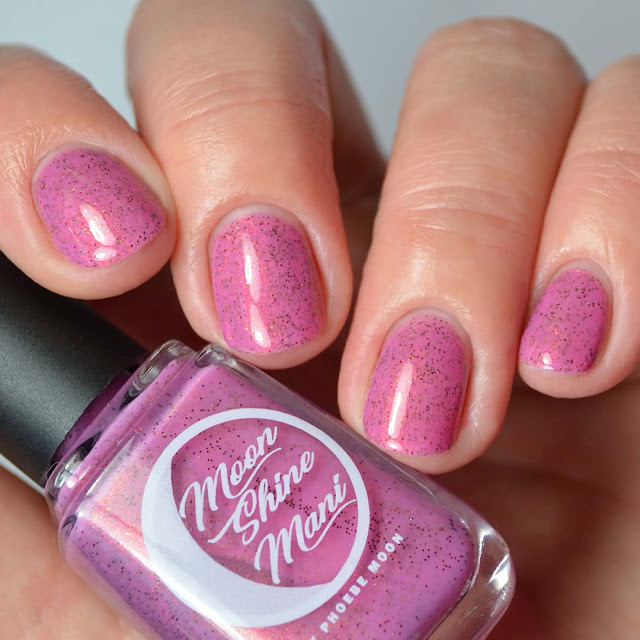 mauve nail polish with shimmer four finger swatch
