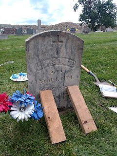 heastone repaired at Fairview Cemetery by members of Evergreen Heritage