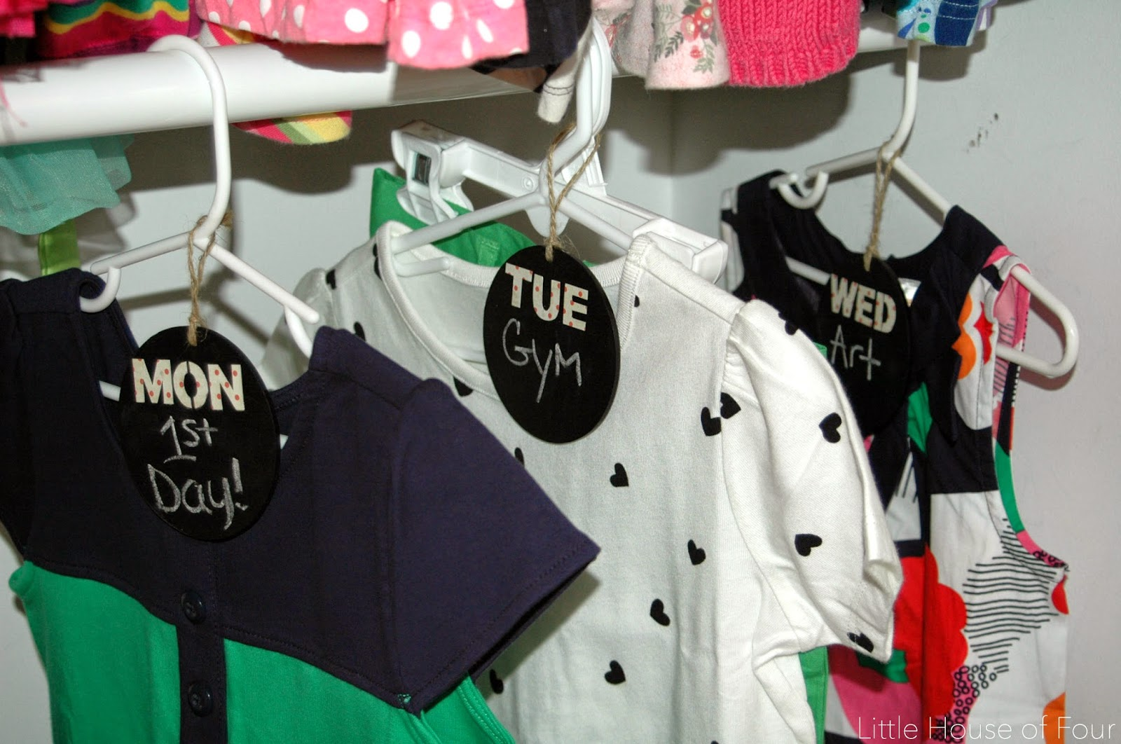 organized closet with weekly chalkboard tags