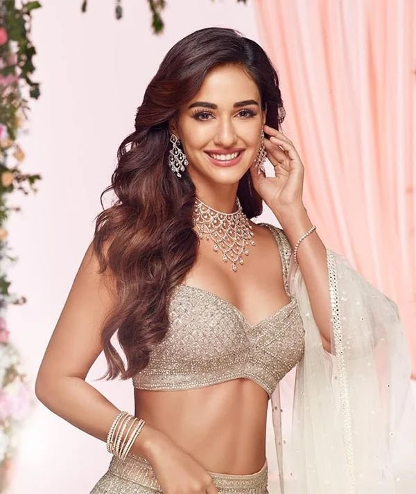 Disha Patani in stunning Indian attire or short white dress? The actress wins fans in both.